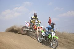 Motocross rider crash, dusty track Royalty Free Stock Photo