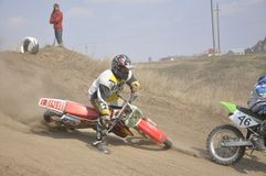 Motocross rider crash, dusty track Stock Images