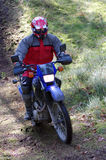 Motocross rider in dirt path royalty free stock photo