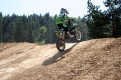 Motocross rider on dirt track. European championship motocross rider in a competition in Zarnesti, Romania Stock Photos