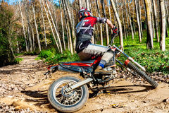 Motocross rider doing spin. Royalty Free Stock Photography