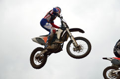 Motocross rider flies through air Royalty Free Stock Photo