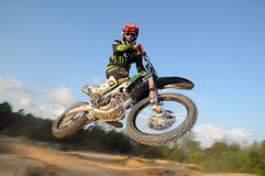 Motocross rider fly high Royalty Free Stock Image
