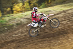 Motocross rider is going uphill. Dynamic shot. Stock Images