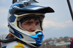 Motocross rider in a helmet Royalty Free Stock Image