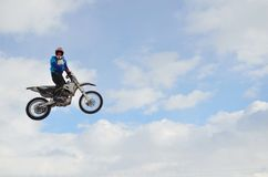 Motocross rider high flight Stock Image