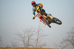 Motocross Rider Jump. A motocross rider performing a stunt royalty free stock image