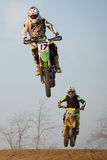 Motocross Rider Jump. Two motocross riders chase each other in the race royalty free stock image
