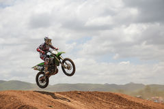 Motocross rider jumping. MUAKLEK, THAILAND - AUGUST 05: Unidentified riders participate in  competition Supercross Championship of Thailand, on August 05, 2012 Royalty Free Stock Photo