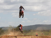 Motocross rider jumping. MUAKLEK, THAILAND - AUGUST 05: Unidentified riders participate in  competition Supercross Championship of Thailand, on August 05, 2012 Stock Photo