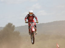 Motocross rider jumping. MUAKLEK, THAILAND - AUGUST 05: Unidentified riders participate in  competition Supercross Championship of Thailand, on August 05, 2012 Stock Image