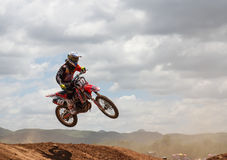 Motocross rider jumping. MUAKLEK, THAILAND - AUGUST 05: Unidentified rider participates in competition Supercross Championship of Thailand, on August 05, 2012 in Stock Images