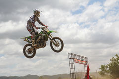 Motocross rider jumping. MUAKLEK, THAILAND - AUGUST 05: Unidentified rider participates in competition Supercross Championship of Thailand, on August 05, 2012 in Stock Photo