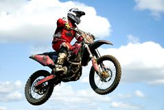 Motocross. Rider jumping in sky stock image