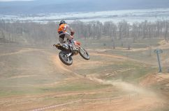 Motocross rider on the motorbike Royalty Free Stock Image