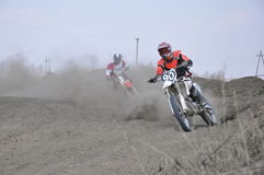 Motocross rider motorbike accelerates from turning Royalty Free Stock Images