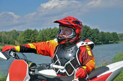 Motocross rider the motorcycle near Royalty Free Stock Photography