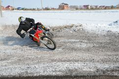Motocross rider performs a turn with the skid Stock Photo