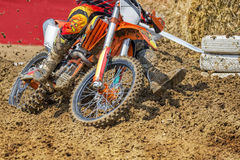 Motocross rider plowing through mud Royalty Free Stock Images