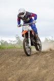 Motocross Rider. Practising on dirt track at Cambois, Blyth, Northumberland. England, UK Stock Photo