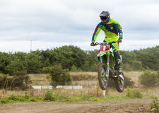 Motocross Rider. Practising on dirt track at Cambois, Blyth, Northumberland. England, UK Stock Image