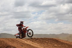 Motocross rider preparing to jump Royalty Free Stock Photos