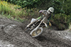 Motocross Rider Race. Rider driving in the motocross race Royalty Free Stock Image