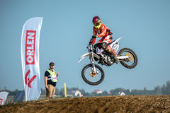 Motocross rider in the race Stock Images
