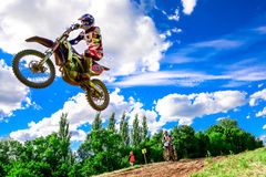 Motocross rider on the race Royalty Free Stock Photo