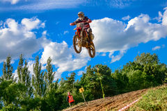 Motocross rider on the race Stock Images