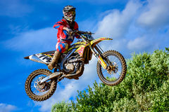 Motocross rider on the race Stock Photos