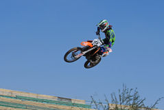 Motocross rider on a track Royalty Free Stock Image
