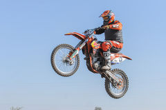 Motocross rider on a track Stock Photos