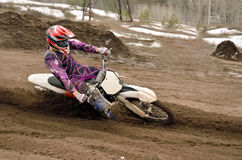 Motocross rider turns point-blank of sand Royalty Free Stock Image