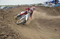 Motocross rider veering point-blank of clay Stock Photos
