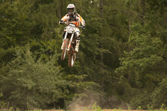 Motocross riders in the jump Stock Images