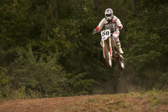 Motocross riders in the jump Royalty Free Stock Photography