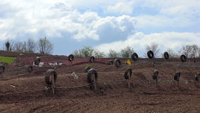 Motocross riders leap into the air during a race stock video footage