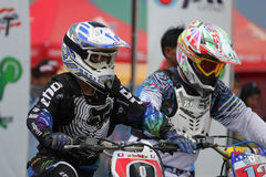 Motocross riders lined up at the start Stock Image