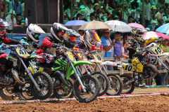 Motocross riders lined up at the start gate Stock Photos