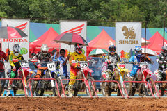 Motocross riders lined up at the start gate Stock Images