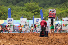 Motocross riders lined up at the start gate Royalty Free Stock Image
