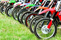 Motocross riders lined up before start Stock Photography