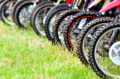 Motocross riders lined up before start Stock Photo