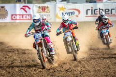 Motocross riders in the race Stock Photography