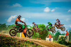 Motocross riders on the race Royalty Free Stock Photo