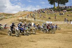 Motocross riders starting Royalty Free Stock Photos