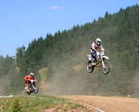 Motocross riders on track Royalty Free Stock Photo