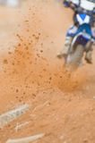 Motocross Roost. Motocross rider accelerating out of a corner, Focus on the roost Royalty Free Stock Photos