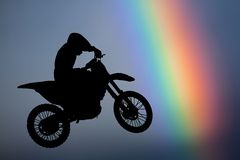 Motocross - silhouette with colorful rainbow Stock Photography